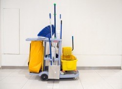 Cleaning tools cart wait for cleaning.Bucket and set of cleaning equipment in the office and Department store. cleaning service concept
