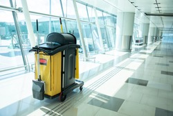 Cleaning tools cart wait for maid or cleaner in the airport. Bucket and set of cleaning equipment in the hospital. Concept of service, worker and equipment for cleaner and health