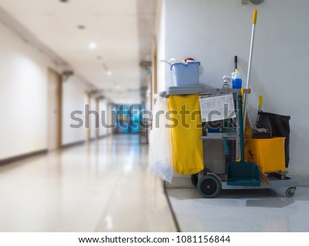 Cleaning tools cart wait for maid or cleaner in the hospital. Bucket and set of cleaning equipment in the hospital. Concept of service, worker and equipment for cleaner and health