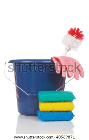 Cleaning tools in a plastic bucket reflected on a white background. Shallow depth of field