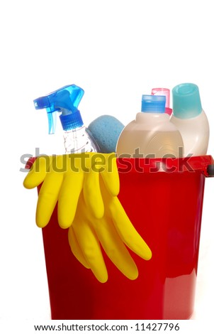 cleaning tools in a red bucket over a white background