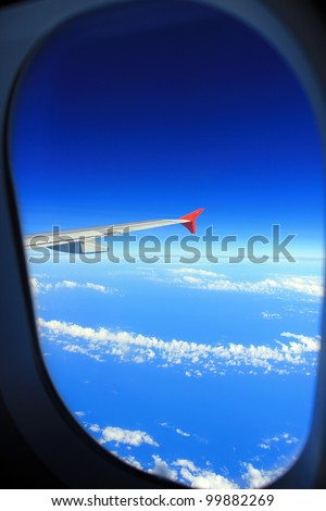 Clear and sky as seen through window of an aircraft