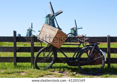 Clear and traditional landmark for Holland: bicycle and mills