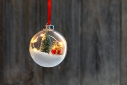 Clear Ball Ornament  with christmas tree,  small gift and christmas light inside.