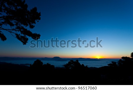 Clear beautiful sunrise over the mountains with the mist of the Huay Nam Dang National Park, Thailand.
