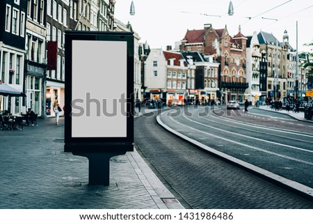 Clear Billboard on city street with blank copy space screen for advertising or promotional poster content, empty mock up Lightbox for information in Amsterdam, blank display outdoors in urban area