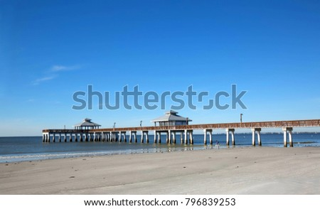 Clear blue skies over the Fishing Pier at Fort Myers Beach located at Times Square a popular tourist destination.