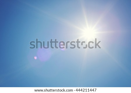 Clear blue sky and sun. Sun rays. Concept of energy, happy, weather forecast or religion. Shiny daylight. - Shutterstock ID 444211447