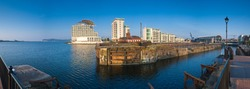 Clear blue sky backdrop against the popular Cardiff bay development in Wales.