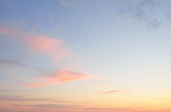 Clear blue sky. glowing pink, golden cirrus and cumulus clouds after storm, soft sunlight. Sunset cloudscape. Meteorology, midnight sun, heaven, peace, graphic resources, picturesque panoramic scenery