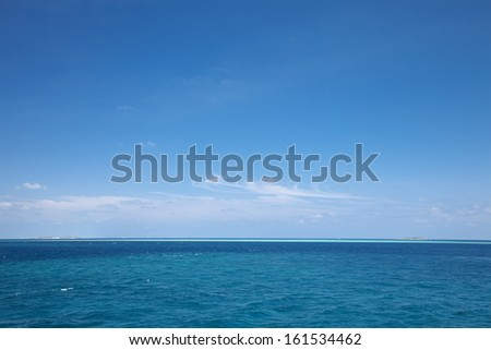 Clear blue sky over the ocean.