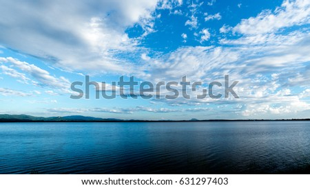 clear blue sky with cloud background #631297403