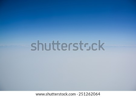 Clear blue sky with horizon line for background