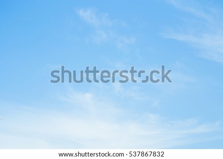 clear blue sky with plain white cloud with space for text #537867832