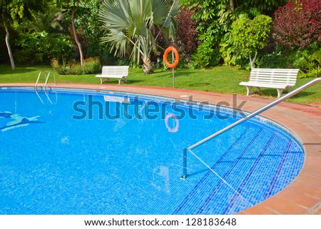 clear blue swimming pool close up in  tropical garden