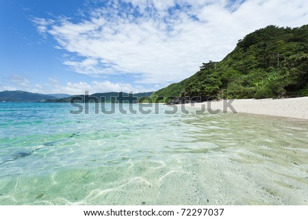 Clear blue turquoise water and white sand tropical beach on coral island, Amami Islands, Kagoshima, Japan