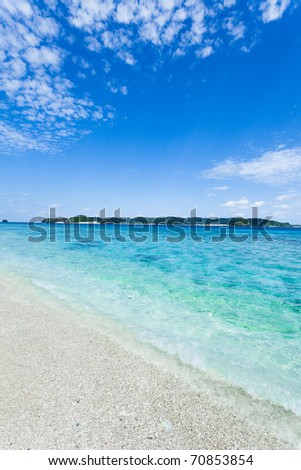 Clear blue water and white sand tropical beach in the coral lagoon of Kerama Islands, Okinawa, Tropical Japan