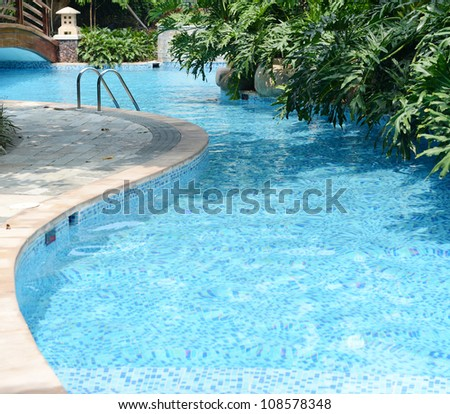 clear blue water in large swimming pool with trees stock photo 108578348 shutterstock. Black Bedroom Furniture Sets. Home Design Ideas