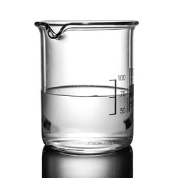 Clear chemical liquid in beaker, white background