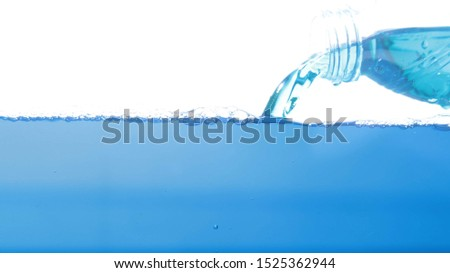 Clear, clear blue water with bubbles on a white background