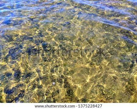 clear clear water of the lake with a rocky bottom