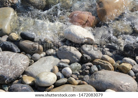 clear clear water on coastal stones in the Mediterranean