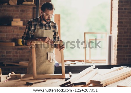 Clear clear without splinters ideal smooth surface of wooden product concept. Professional serious busy smart confident focused thoughtful cabinet maker using sandpaper at table industrial interior #1224289051