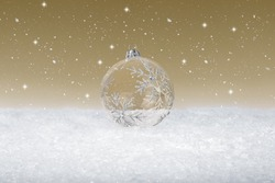 Clear Glass Christmas Bauble on fake white snow