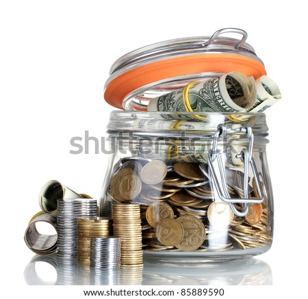 Clear glass jar for tips with money isolated on white (Ukrainian coins)