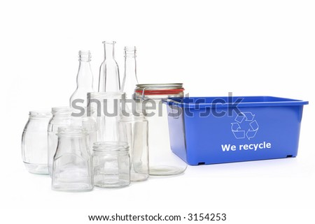 Clear glass jars and bottles and blue plastic disposal bin with white recycle symbol over white