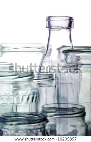 Clear glass jars and bottles on white - stock photo