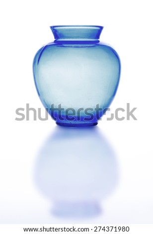 stock-photo-clear-glass-vase-and-its-reflection-on-bright-background-the-glass-is-blue-in-color-the-vase-has-274371980.jpg