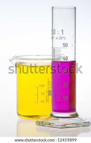 clear laboratory beaker and calibrated cylinder filled with color liquids on white background