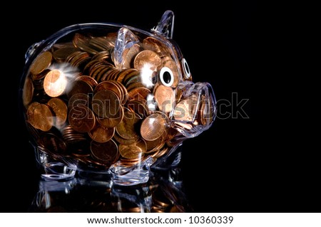 Clear plastic piggy bank full of american pennies