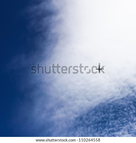 Clear propeller aircraft in blue sky