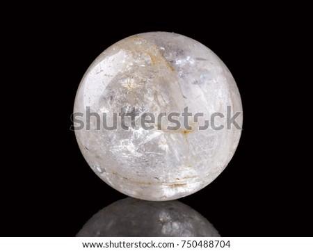 Clear quartz sphere on black #750488704