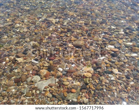 clear sea and small pebbles Stok fotoğraf ©