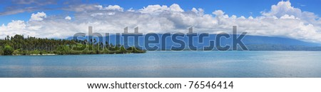Clear sea blue sky with clouds and wild beach with palm trees