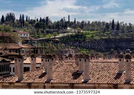 Clear shoot of old moslem theological school roof with layers of hills in Safranbolu #1373597324