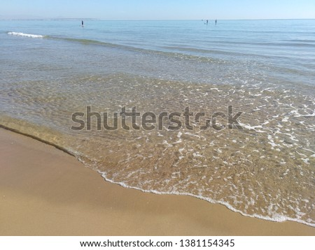 Clear sky and clear water on the beach