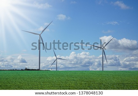 clear sky green meadow with Wind turbines generating electricity #1378048130