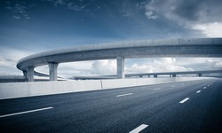 Clear sky, highway pavement under the overpass