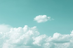 clear turquoise sky with simple white cloud with space for text background.