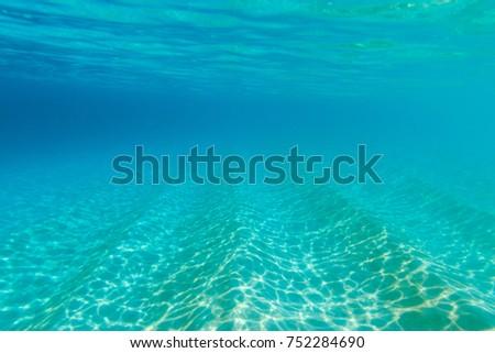 Clear turquoise water of Doo Island near Rote Ndao, East Nusa Tenggara province, Indonesia. Underwater image.