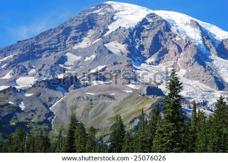 stock-photo-clear-view-across-a-meadow-of-snow-covered-mount-rainer-near-seattle-washington-usa-25076026.jpg
