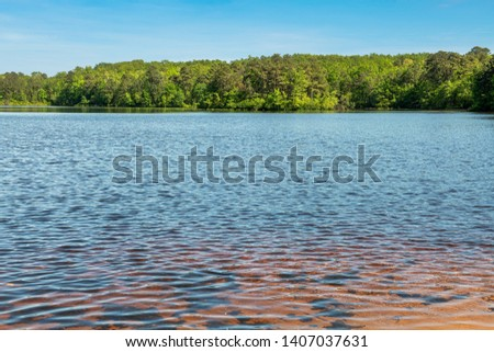 Clear water and clear sky over Prospertown Lake in Jackson New Jersey.
