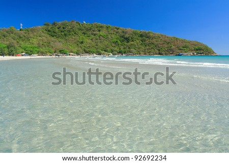 Clear water and white sand beach in daytime , Thailand.
