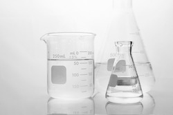 clear water in beaker and flask in white medical science laboratory background