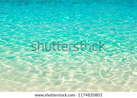 Clear water reflections on shallow sandy beach bottom, Thailand in a summer day #1174820803