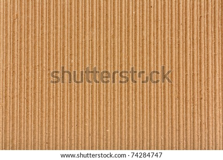 Clear yellow corrugated cardboard texture. Closeup. Horizontal